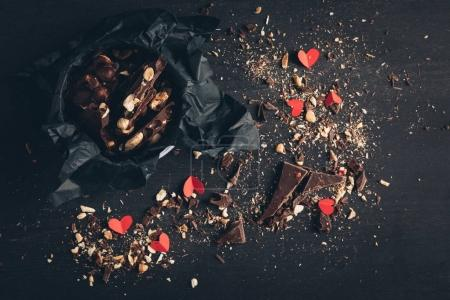 shredded chocolate and red paper hearts
