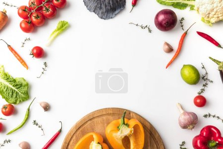 Photo for Top view of bell peppers on wooden board isolated on white - Royalty Free Image
