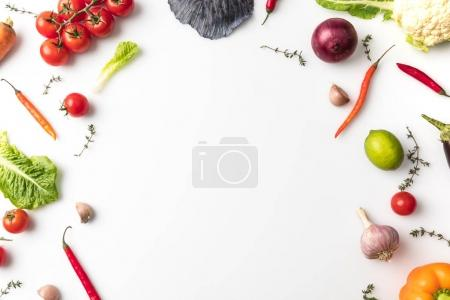 Photo for Top view of different vegetables for salad isolated on white - Royalty Free Image