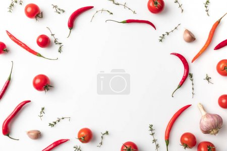 circle of chili peppers and tomatoes