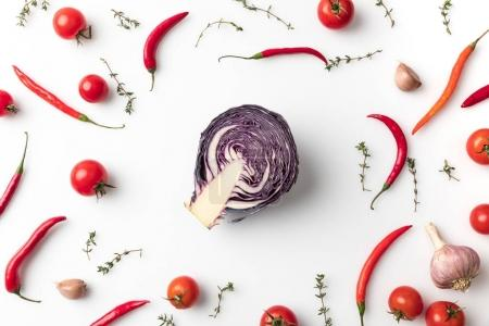 Red cabbage among chili peppers