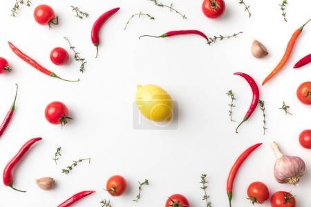 lemon among chili peppers and tomatoes