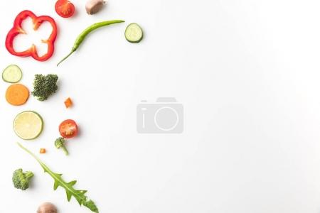 Photo for Top view of cut different vegetables for salad isolated on white - Royalty Free Image
