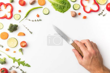 Photo for Cropped image of man putting knife on table isolated on white - Royalty Free Image