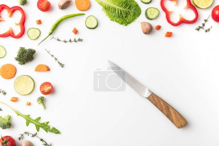 Photo for Top view of knife with vegetables isolated on white - Royalty Free Image