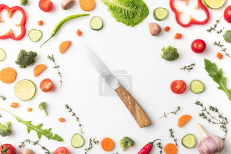 knife in circle of cut vegetables
