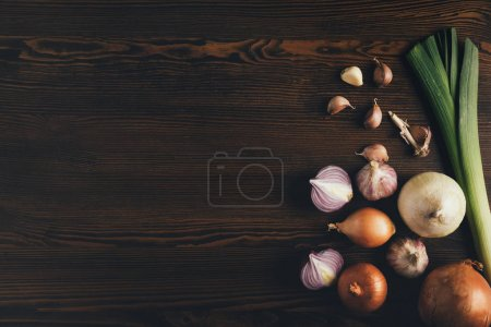 onion and garlic on brown tabletop