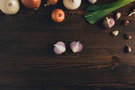Photo for Top view of onion and garlic on a grungy surface - Royalty Free Image