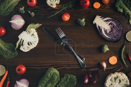 knife and fork with vegetables