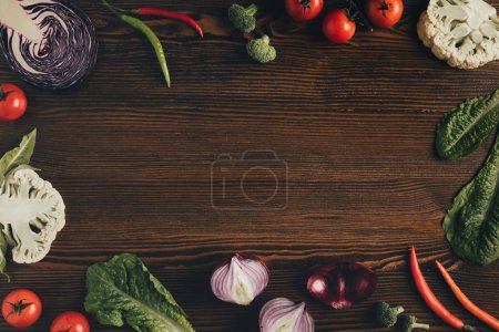 Photo for Top view of different vegetables on brown table - Royalty Free Image