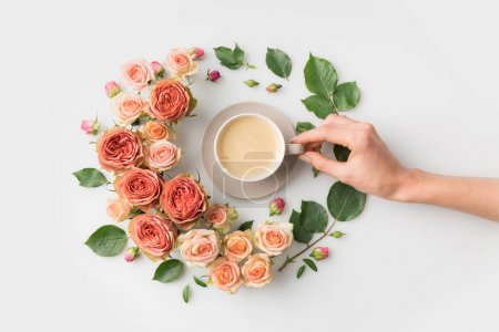 flower wreath with coffee cup
