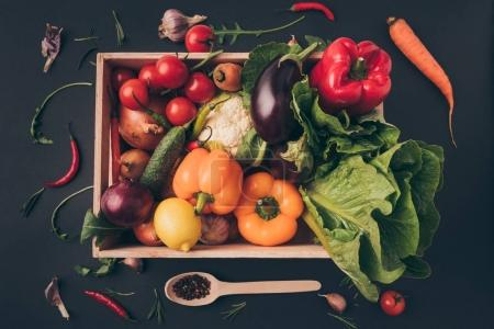 Photo for Top view of wooden box with ripe vegetables on gray table - Royalty Free Image