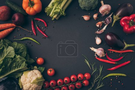 Photo for Top view of unprocessed vegetables on a gray table - Royalty Free Image