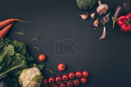 Photo for Top view of raw vegetables on gray table - Royalty Free Image