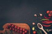 """Постер, картина, фотообои """"вид сверху помидоры черри и специй на серый стол"""""""