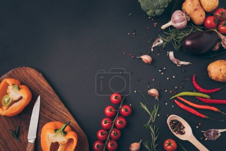 top view of vegetable ingredients for dish on gray table