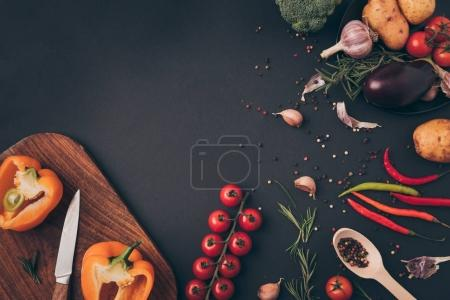 Photo for Top view of vegetable ingredients for dish on gray table - Royalty Free Image