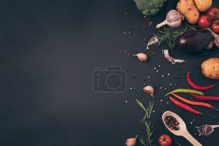 Photo for Top view of spices and vegetables on gray surface - Royalty Free Image