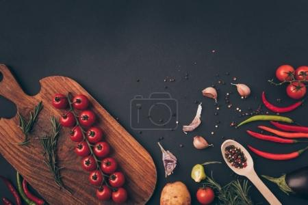 top view of vegetables and spices on gray table