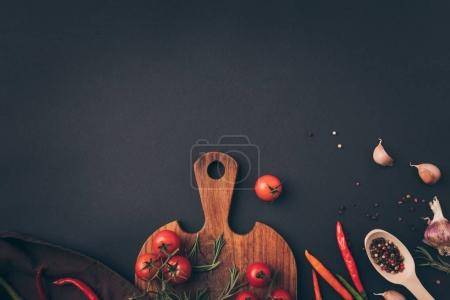 Photo for Top view of cherry tomatoes and fennel with garlic on gray table - Royalty Free Image