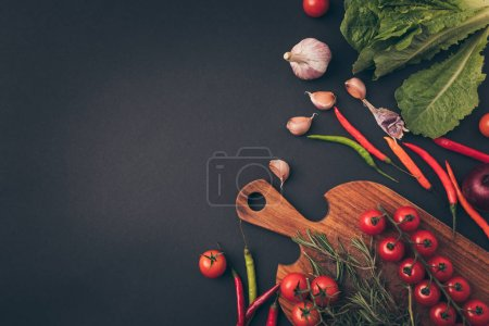 Photo for Top view of on gray cherry tomatoes on wooden board - Royalty Free Image
