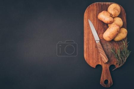 Photo for Top view of wooden board with raw potatoes on gray table - Royalty Free Image