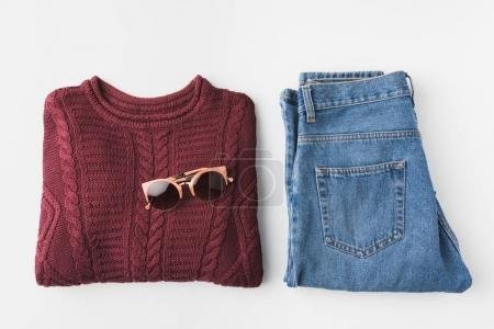 trendy knitted sweater and jeans and sunglasses
