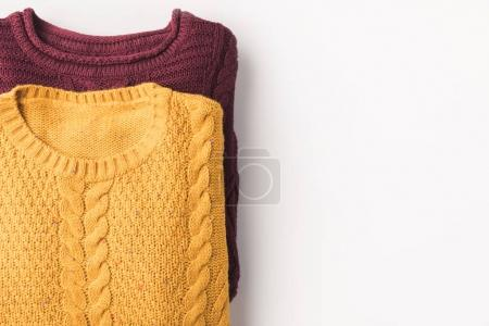 burgundy and yellow sweaters
