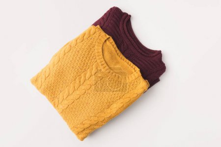 knitted burgundy and yellow sweaters
