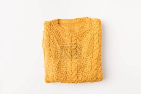 Photo for Top view of knitted yellow sweater, isolated on white - Royalty Free Image