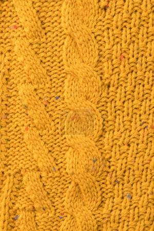 Photo for Texture of warm knitted yellow sweater with pattern - Royalty Free Image