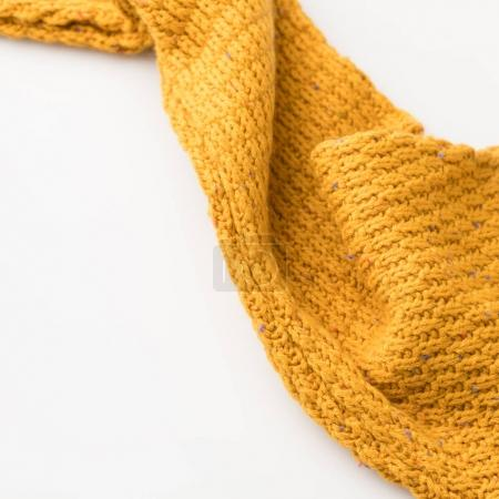 Photo for Top view of sleeve of yellow knitted sweater, isolated on white - Royalty Free Image