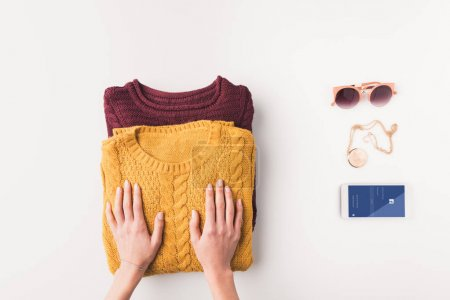 sweaters and smartphone with facebook appliance