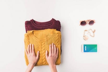 sweaters and smartphone with twitter