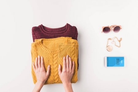sweaters and smartphone with skype