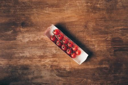 Photo for Top view of Cherry tomatoes on wooden table - Royalty Free Image