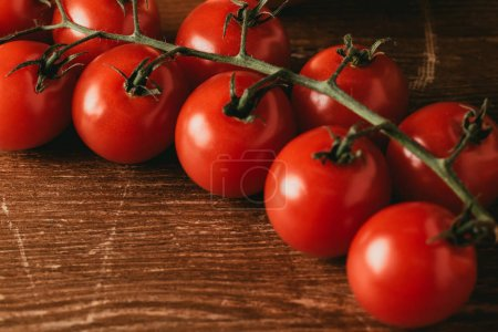 close up of Cherry tomatoes on wooden tabletop