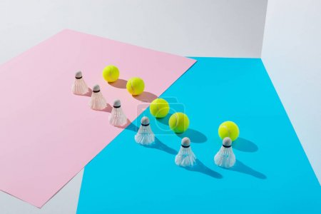 badminton shuttlecocks and tennis balls on pink and blue