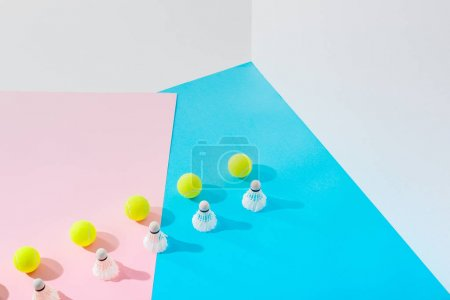 rows of badminton shuttlecocks and tennis balls on pink and blue