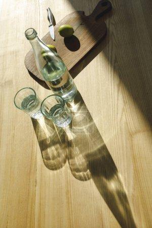 overhead view of lemonade ingredients on wooden table