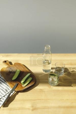 overhead view of preparing detox water with cucumbers