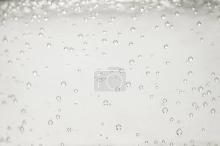 close up view of mineral water with bubbles