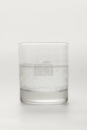 Glass with sparkling mineral water isolated on white