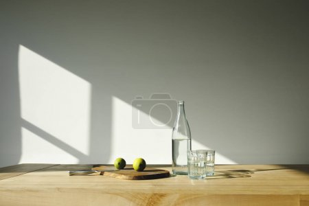 detox water with lime ingredients on brown wooden table