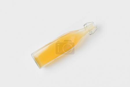 bottle of refreshing apple cider isolated on white