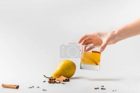 Photo for Cropped shot of woman holding glass of pear cider with spices - Royalty Free Image