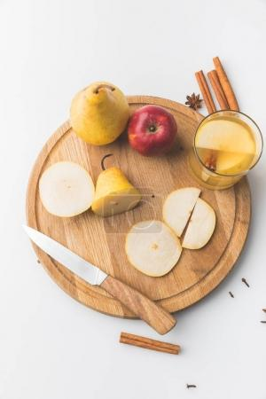 top view of cider with apple and pear on wooden board on white