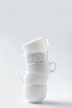stack of six white cups isolated on white