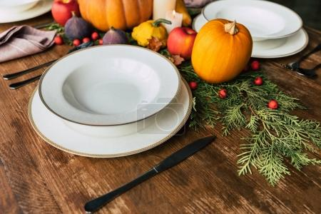 Close-up shot of table setting with beautiful autumn  decor