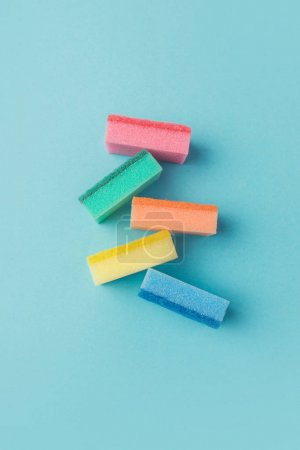 top view of colorful washing sponges, on blue